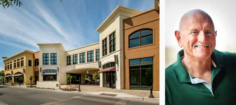 Storefront buildings near a sidewalk & road & a separate image of Thomas L. Martinelli's headshot.